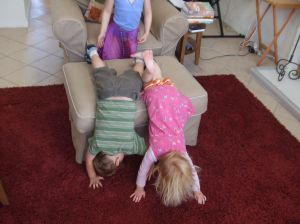 First the twins get a gymnastics lesson from big sister...